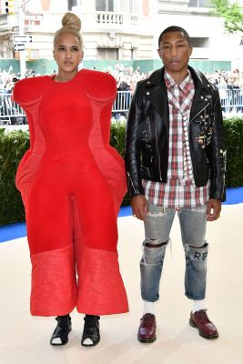Helen Lasichanh and Pharrell Williams, both in Comme des Garçons