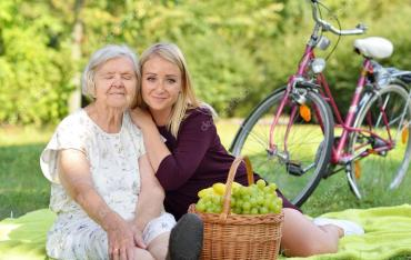 depositphotos_124952194-stock-photo-grandmother-and-granddaughter-at-picnic